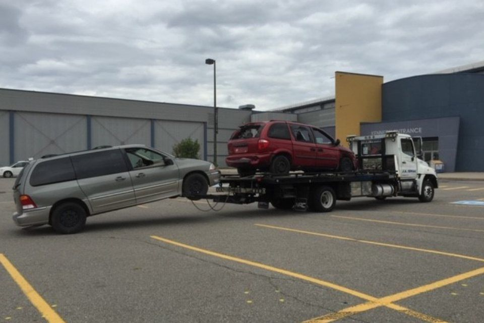 truck towing 2 cars