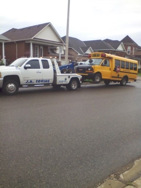 truck towing a school van
